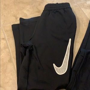 Two pairs of Nike black sweatpants